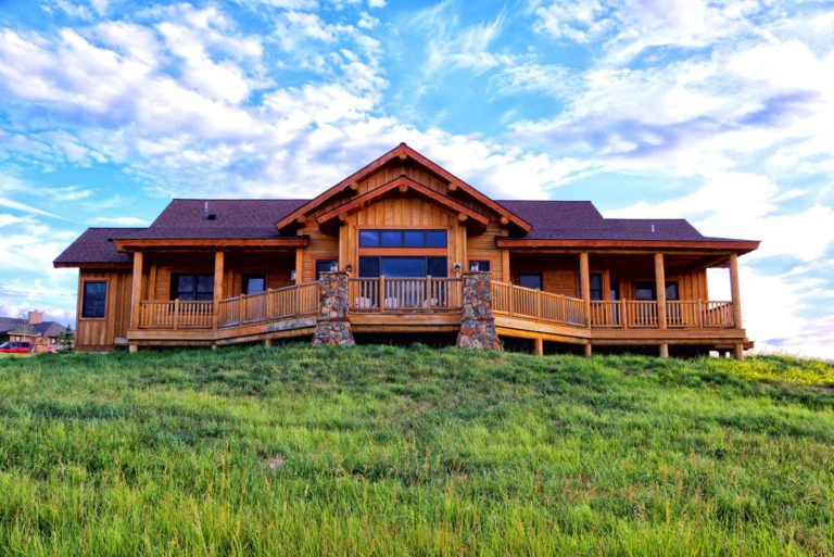 Front view of Sweetgrass Ranch highlights its expansive wraparound porch.